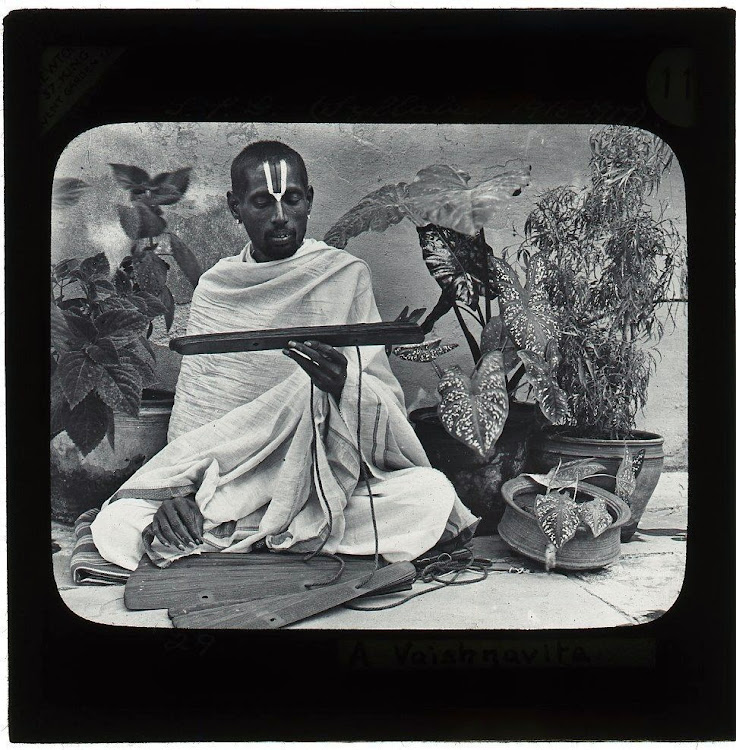 A Hindu Man Reading Scripture - Lantern Slide c1910's