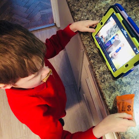 David plays with his iPad while trying a flapjack - ideas to help my fussy eaters