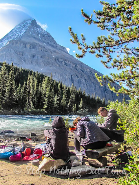 Breakfast next to the Robb River, Mt. Robson in the background. Hiking the Berg Lake Trail in the Canadian Rockies.