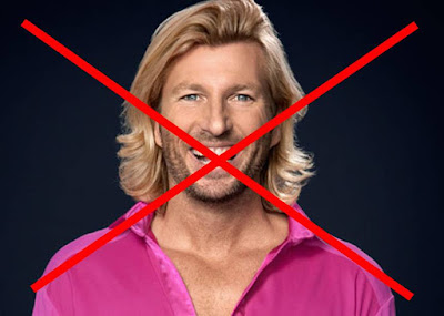 Robbie-Savage-in-pink-shirt-with-red-cross-over-his-face