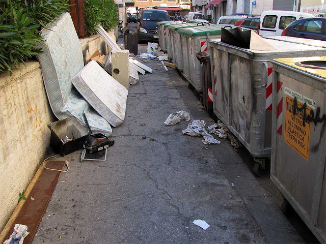 Piles of garbage near dumpsters, via Santa Fortunata, Livorno