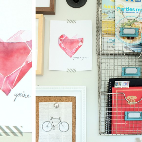 Art, cards, and magazines adorn the wall in this office desk and gallery wall reveal.
