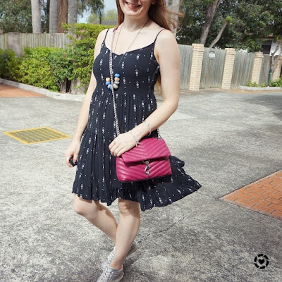 awayfromtheblue little black tiered printed sundress with silver glitter sneakers rebecca minkoff edie crossbody bag