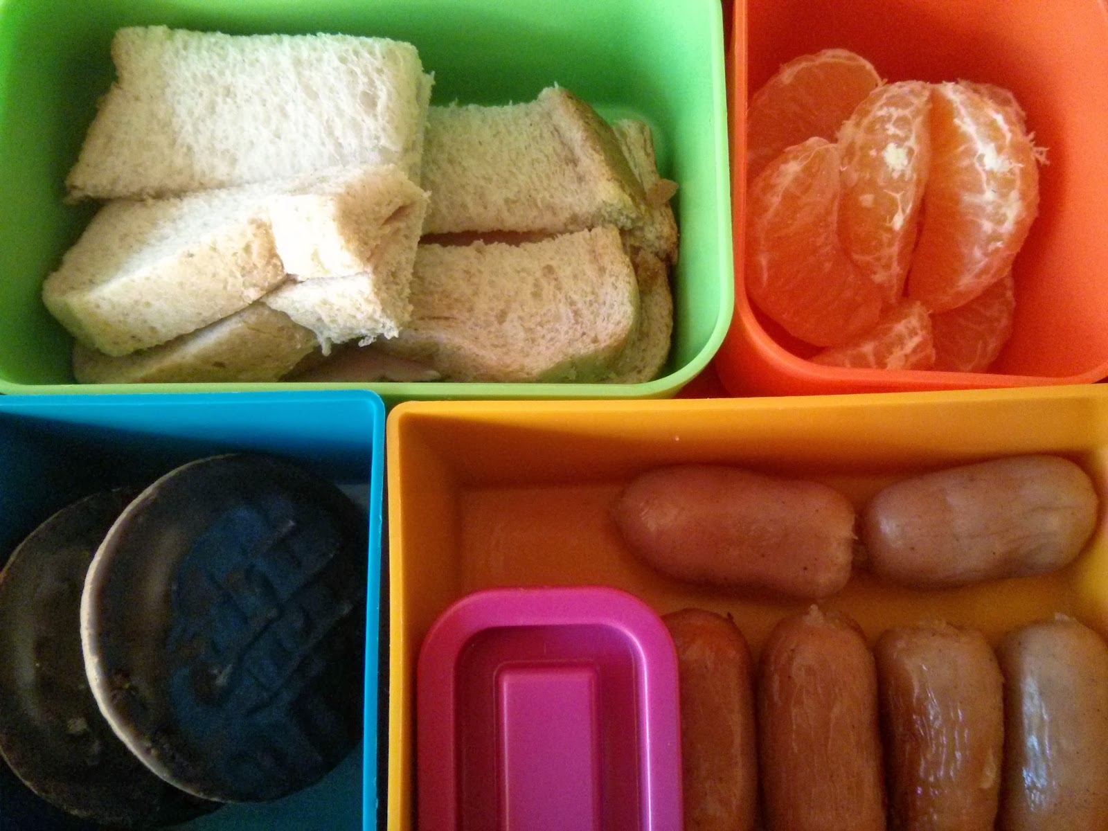 Finger Sandwich, Satsuma, Jaffa Cakes and mini sausages with ketchup
