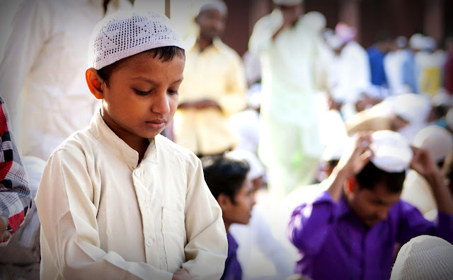 Image Attribute; A Child paying Namaaz in India / Source: Flickr Creative Commons
