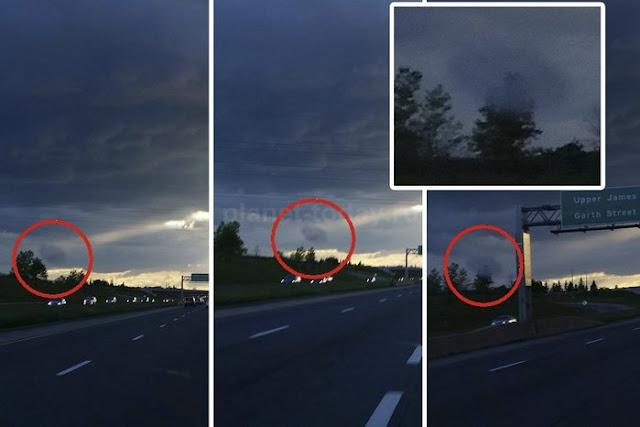 В Канаде сфотографировали странное темное облако, летящее низко над землей