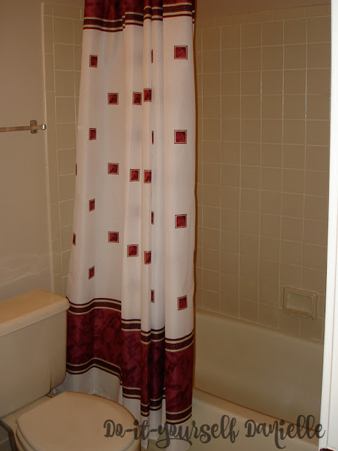 1980's style master bathroom in a condominium- bathtub and toilet.