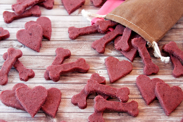 Homemade pink dog treats shaped like bones and hearts
