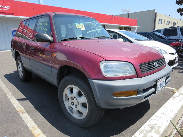 97 RAV4 with delaminating paint & dents prior to repair & painting at Almost Everything Auto Body