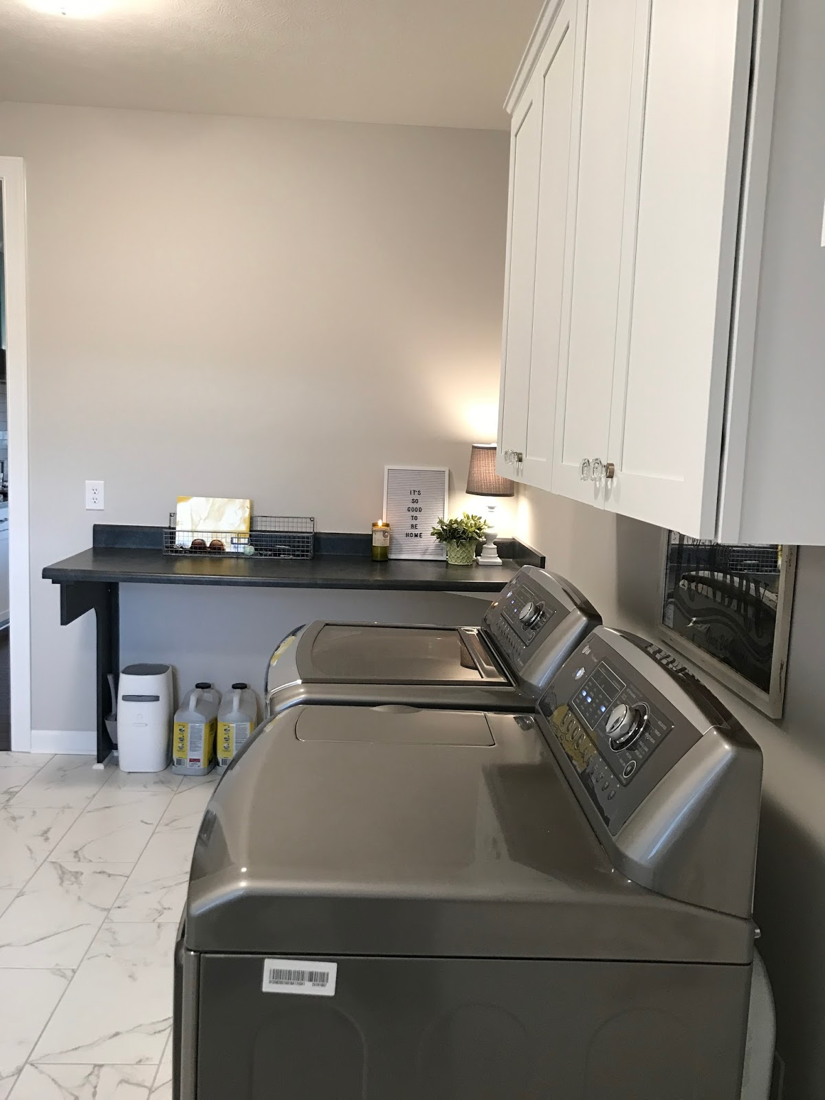 Laundry room with faux marble tile