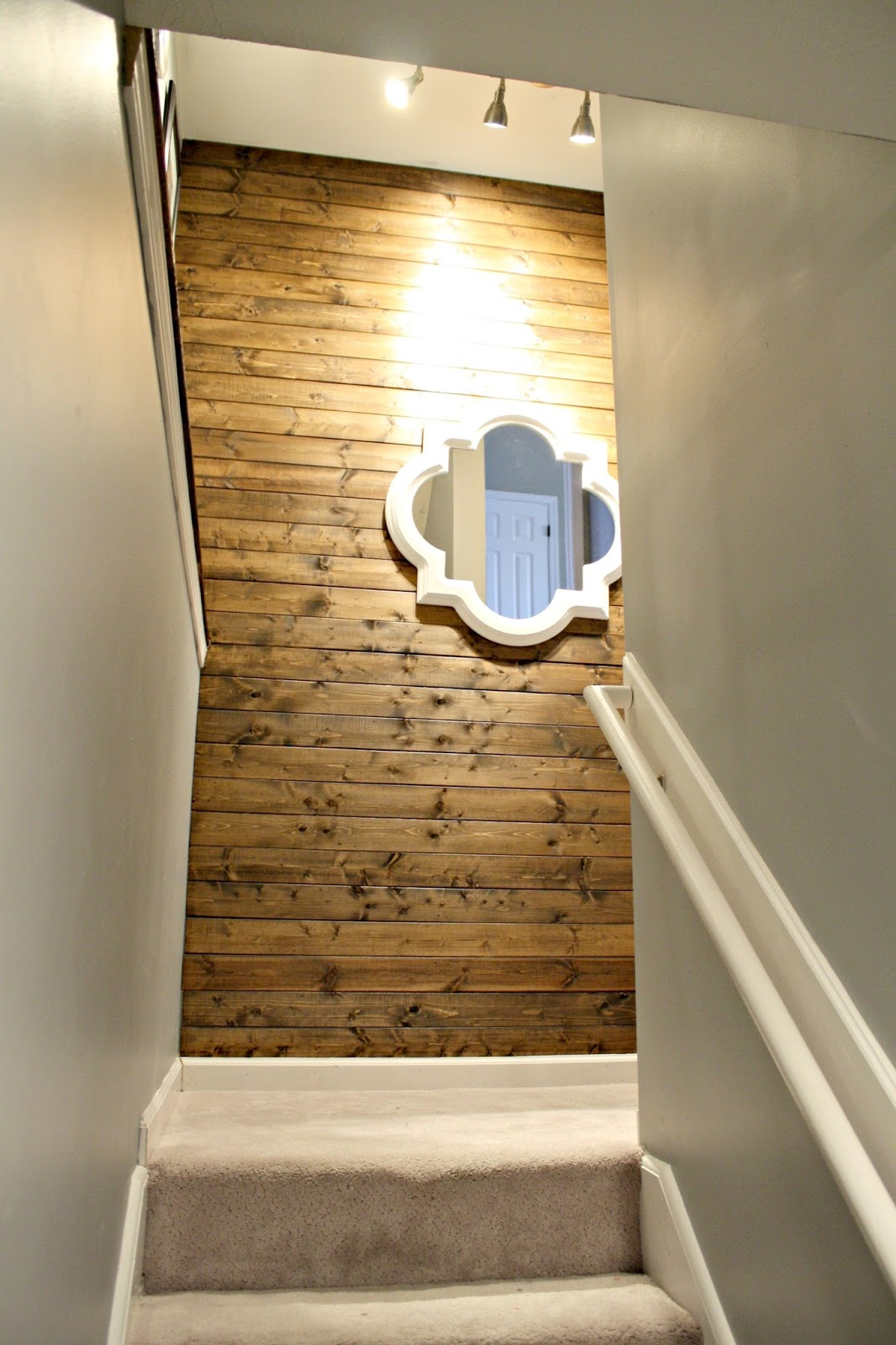wood planked wall stairs