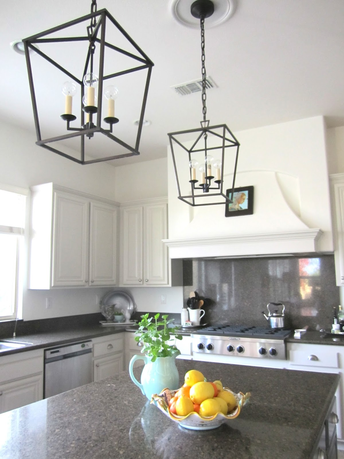 a phased decorating approach lantern kitchen lighting Notice the round light bulbs for a fun look There s no glass in these lanterns which is good since glass is hard to keep clean in kitchens