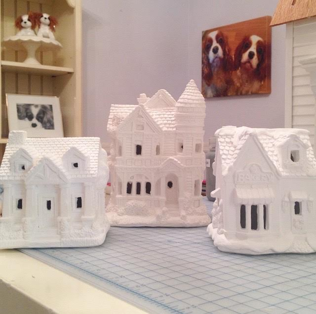 Unpainted plaster Christmas village houses by California Creations