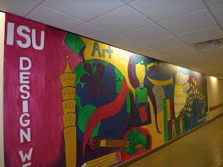a vibrantly colored mural in the Sioux City downtown skywalk system painted by Iowa State University Design West students