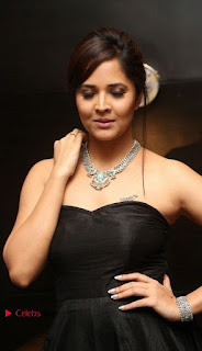 Telugu Anchor Actress Anasuya Bharadwa Stills in Strap Less Black Long Dress at Winner Pre Release Function  0015.jpg