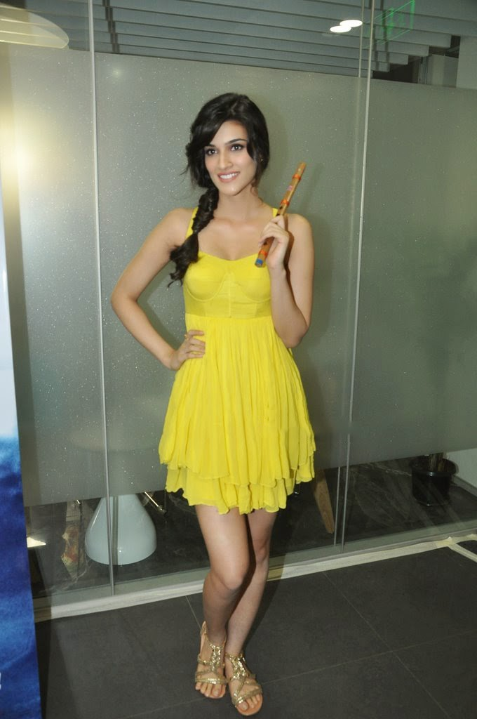 Kriti Sanon Hot Lags Show Photoshoot Stills In Yellow Top