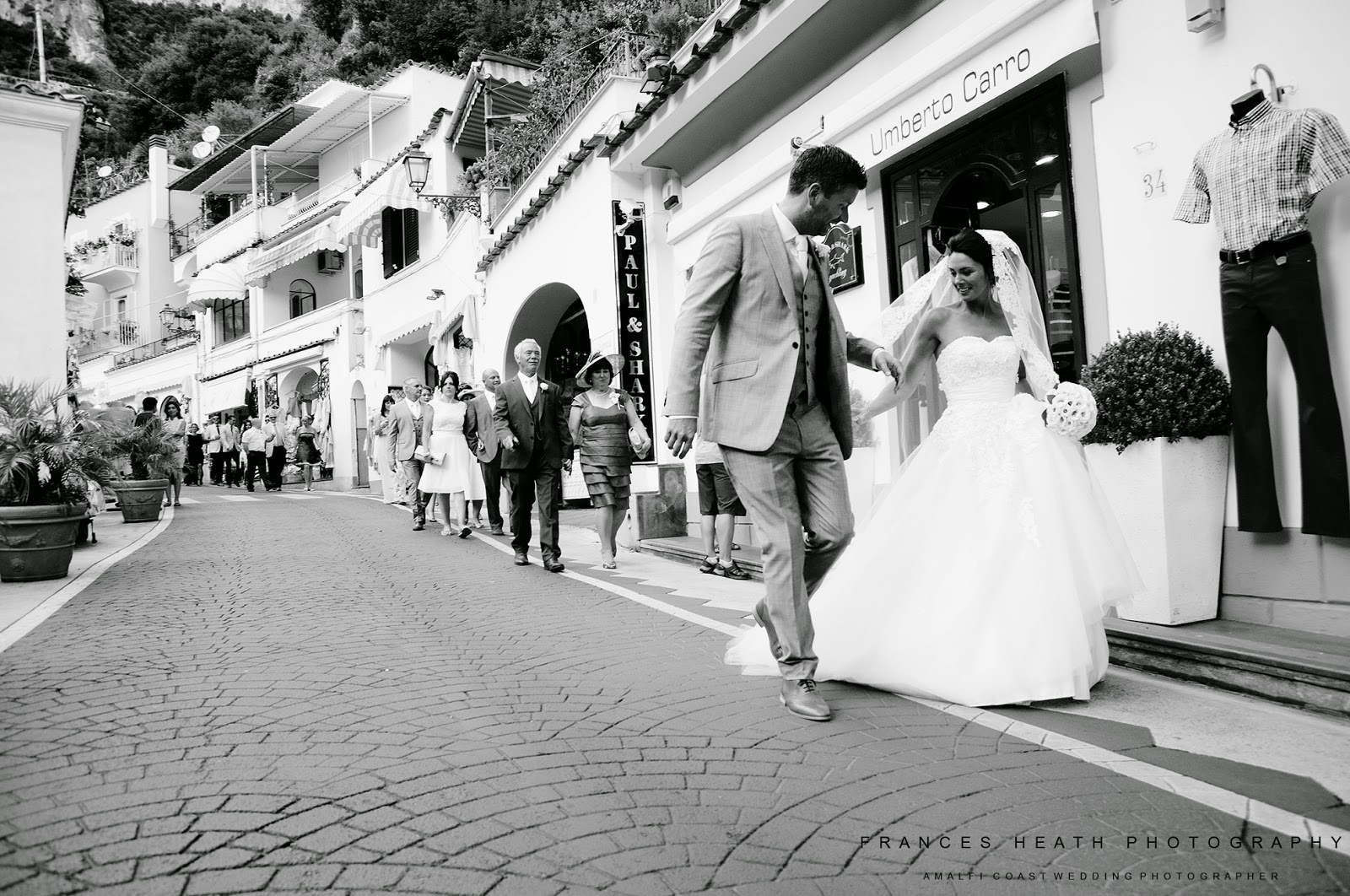 Wedding party walking in Positano Italy