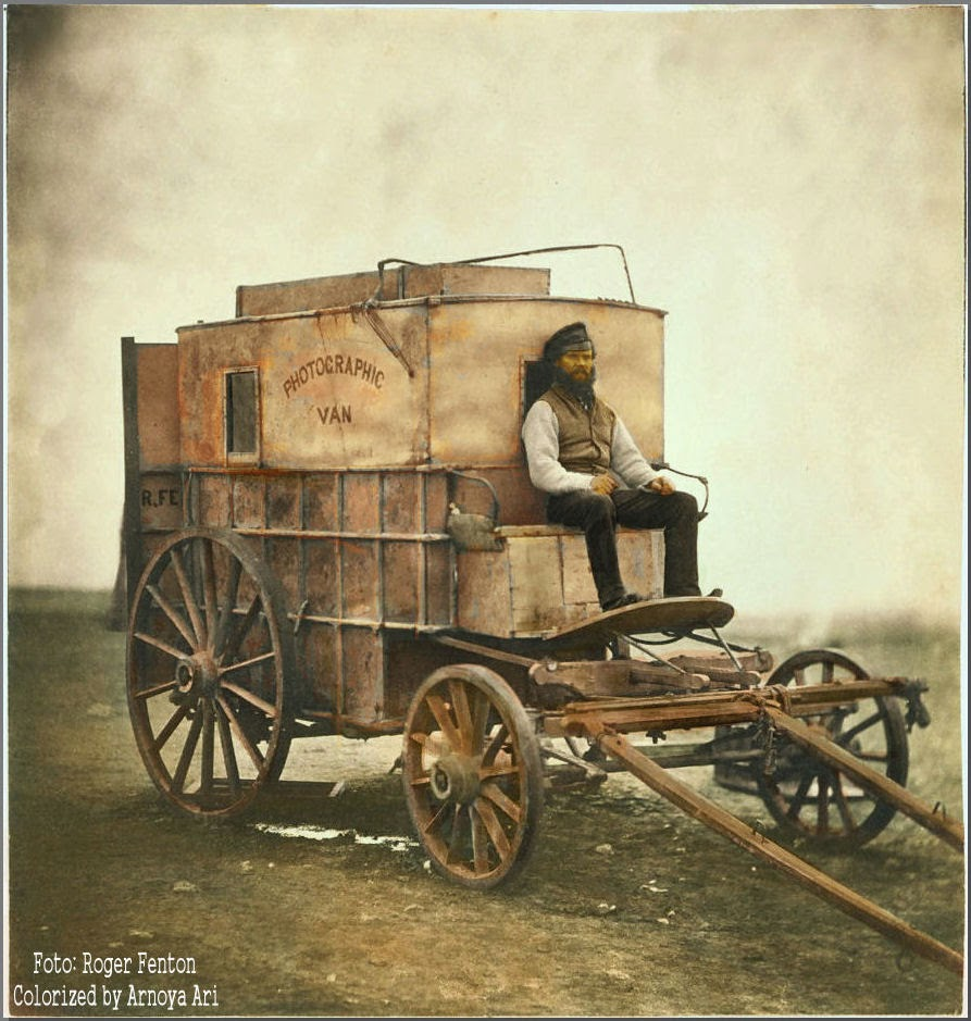 Marcus Sparling seated on Roger Fenton's photographic van, Crimea, 1855,color colorization colorized