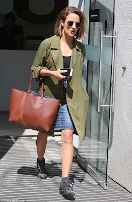Caroline Flack in a Topshop coat and denim skirt