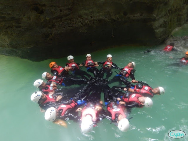 Kawasan Canyoneering trek group enjoying their company