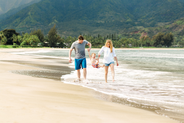 family stroll on the beach at Hanalei Bay, Kauai