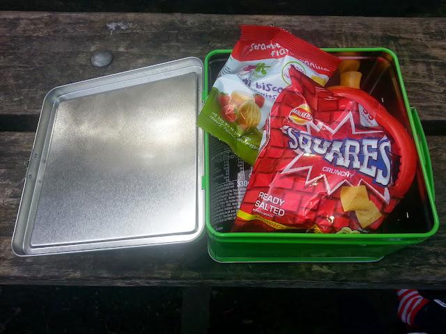 open lunch box showing snacks inside