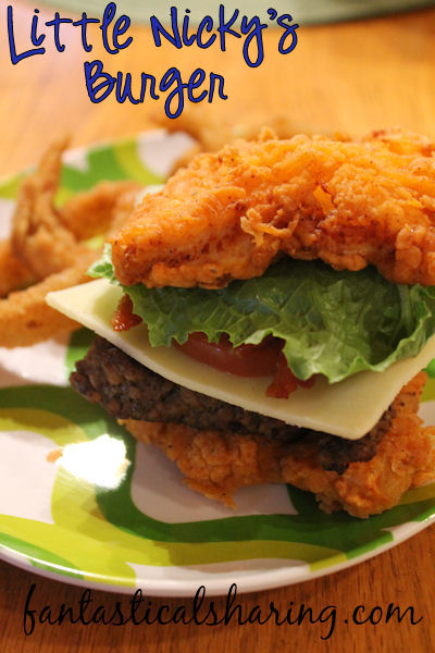 Little Nicky's Burger | This over-the-top burger is nestled between 2 pieces of spicy Popeye's chicken! #copycat #recipe #burger