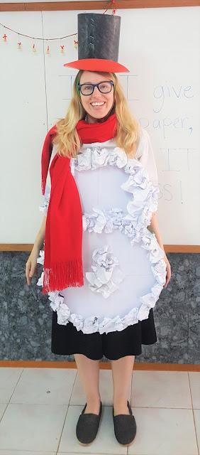 An ESL teacher wearing a Frosty the Snowman costume