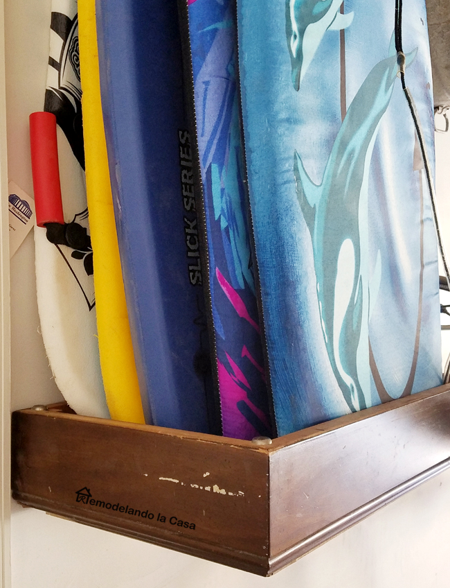 garage organization, diy, snowboards and boogie boards storage