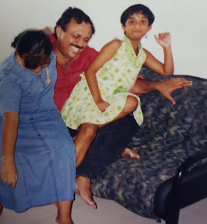 Keerthy Suresh with Cute and Awesome Smile with her Mom and Dad in Childhood