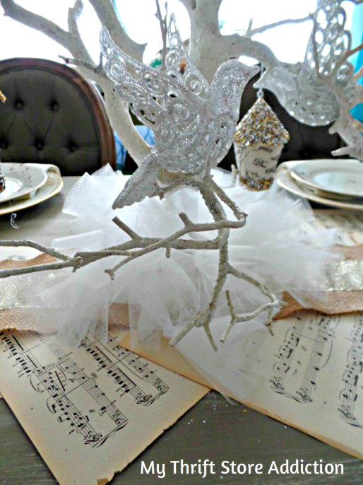 Snowy Tulle Garland mythriftstoreaddiction.blogspot.com Snowy tulle garland at the base of Christmas centerpiece