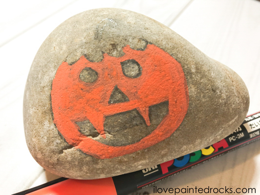 How to draw a jack-o-lantern on a rock