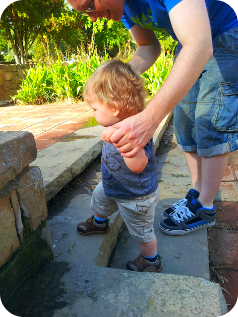 learning to climb stairs, Park guell, barcelona with a toddler