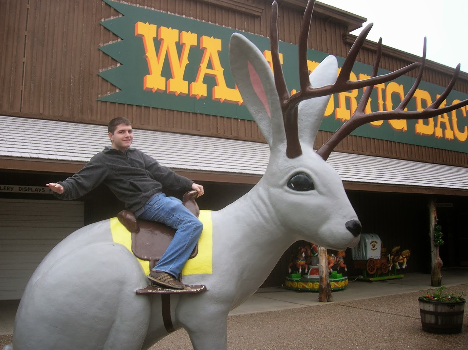 man riding a jackalope at wall drug