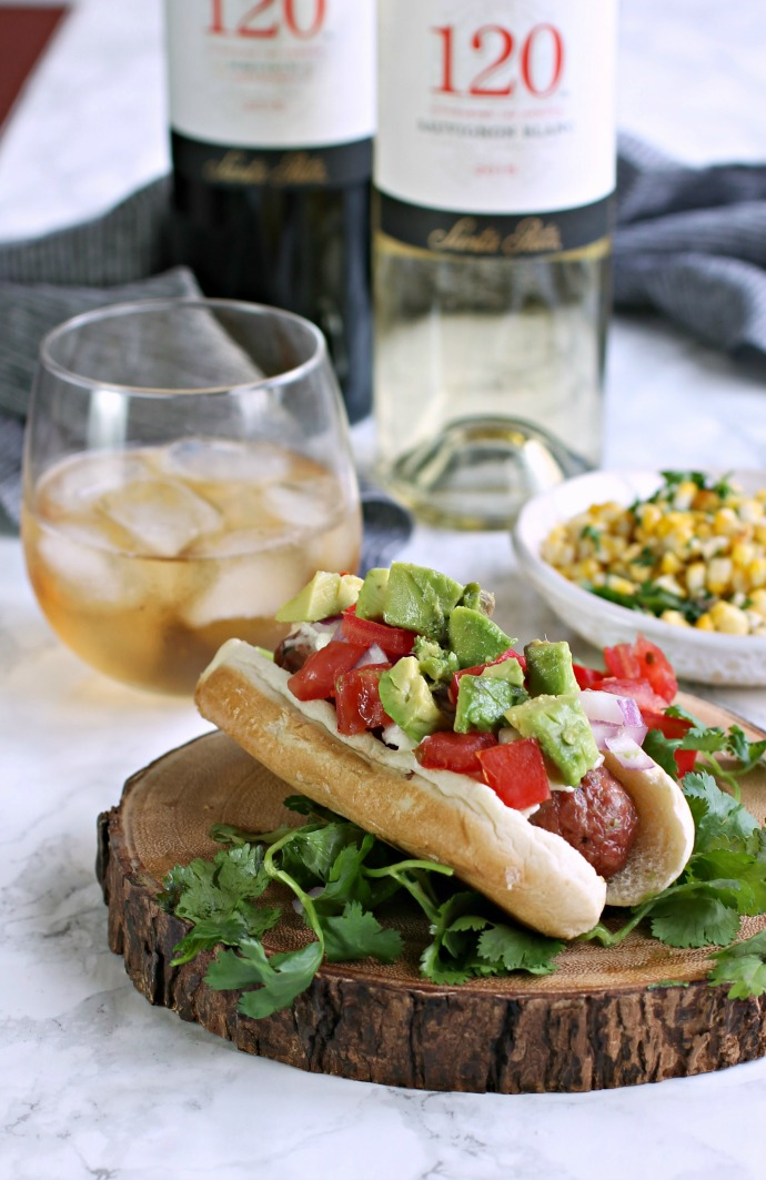 Recipe for a loaded hot dog sandwich with Latin flavors and a roasted corn.