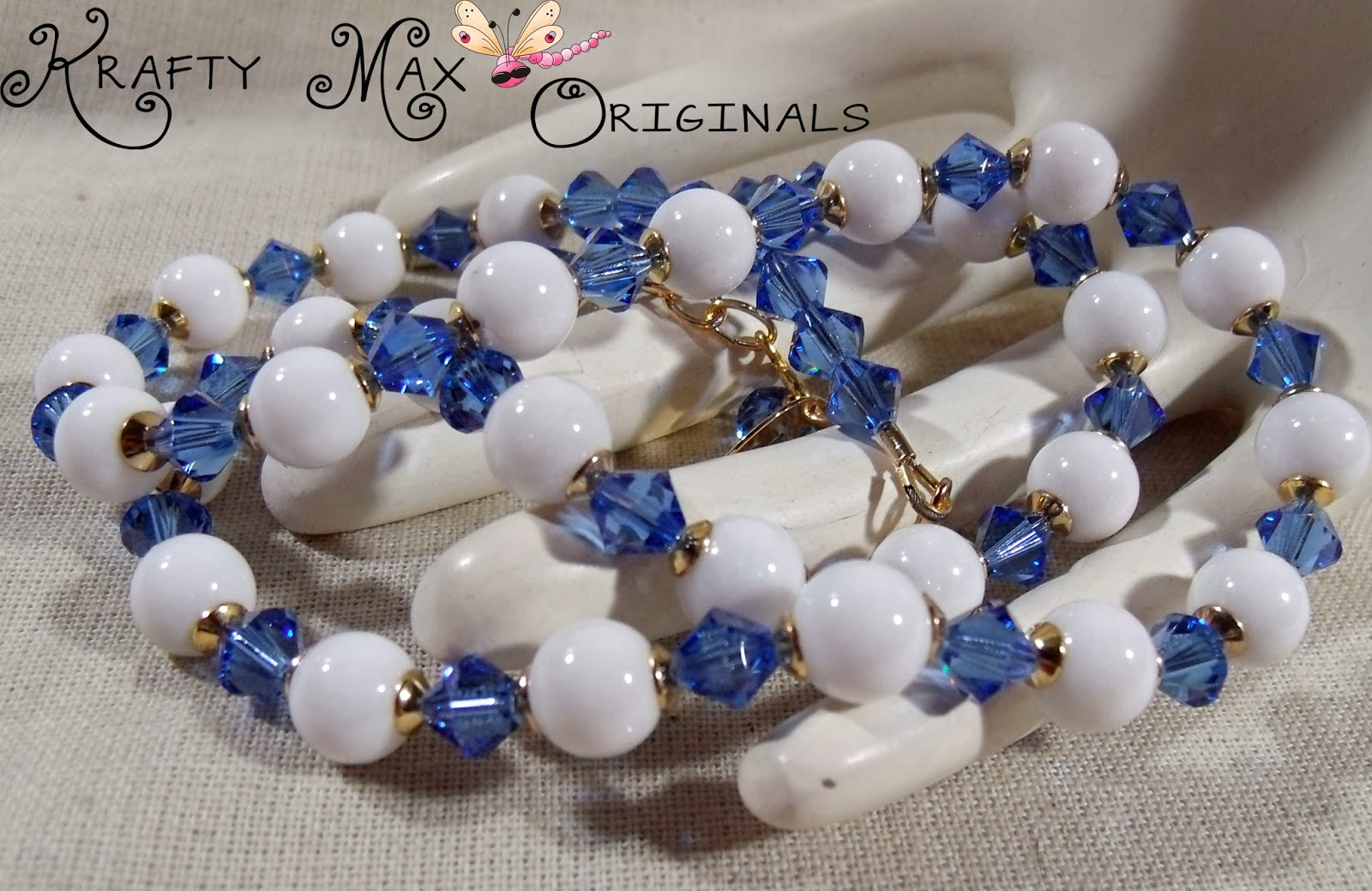 http://www.artfire.com/ext/shop/product_view/KraftyMax/8548358/white_mountain_jade_andamp_blue_swarovski_crystals_w_gold_plated_findings/handmade/jewelry/sets/crystal
