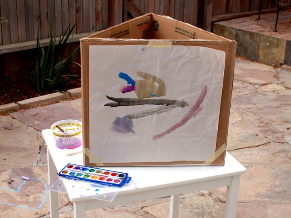 How to make an art easel for 3 kids from a cardboard box