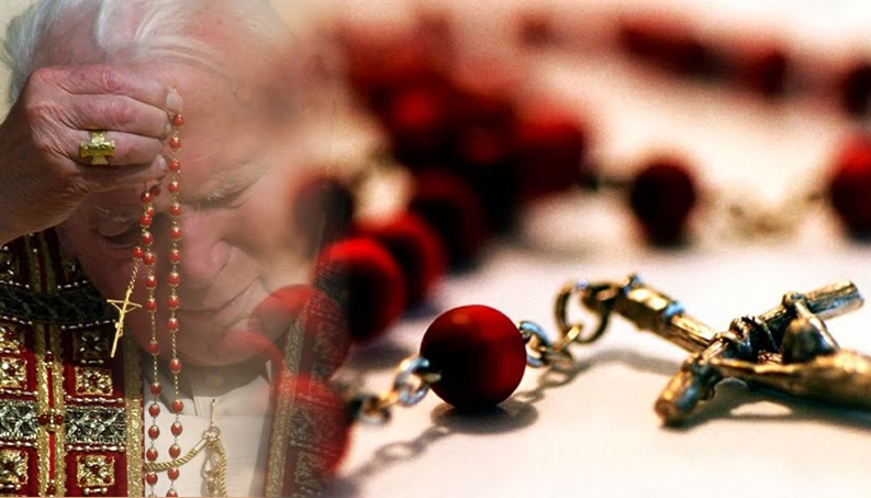 A photomontage of St. John Paul II and Rosary beads