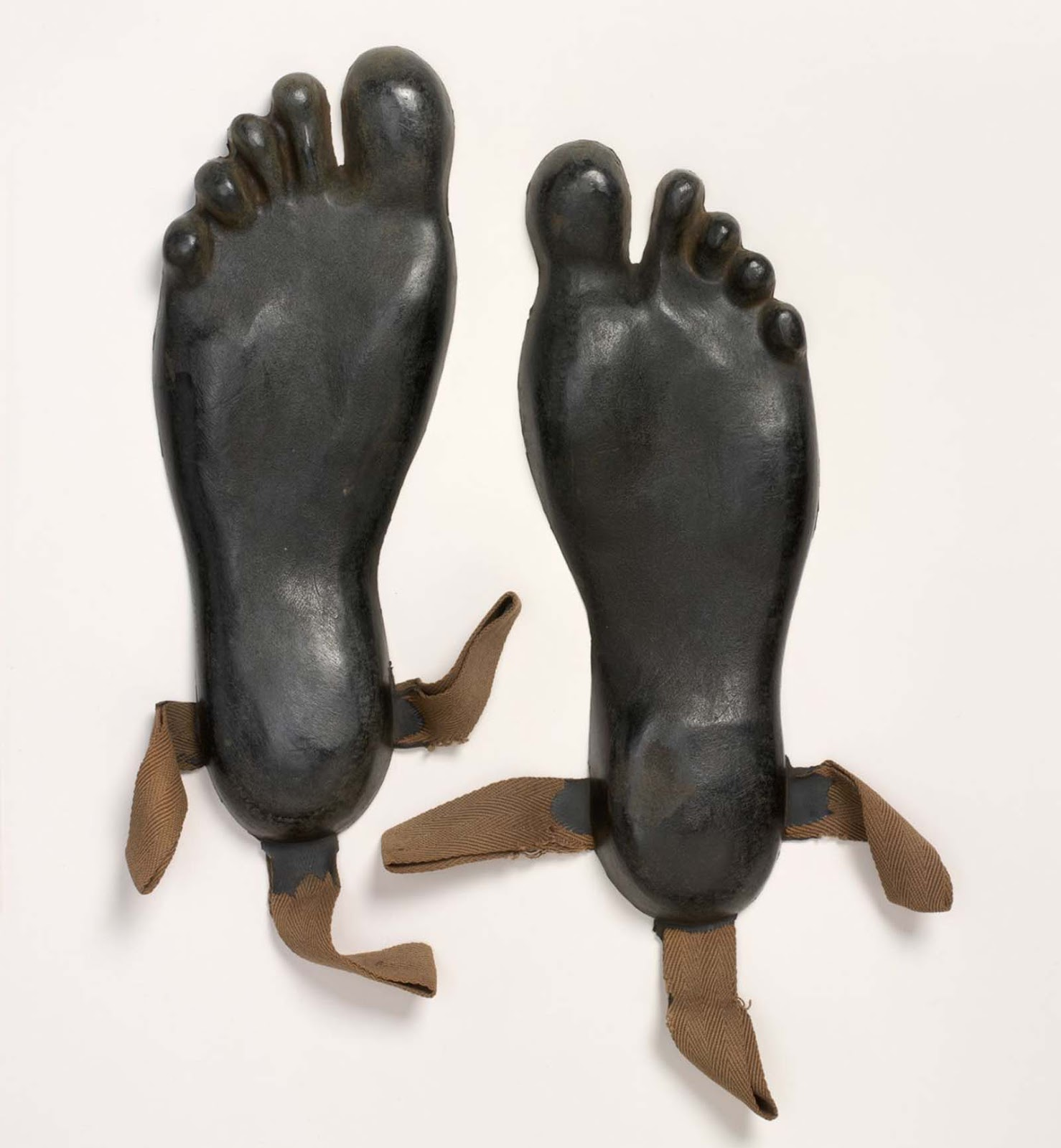 These overshoes were made for Britain's Special Operations Executive (SOE) agents operating in Asia and the Pacific. When the agent landed on a beach from the sea, the