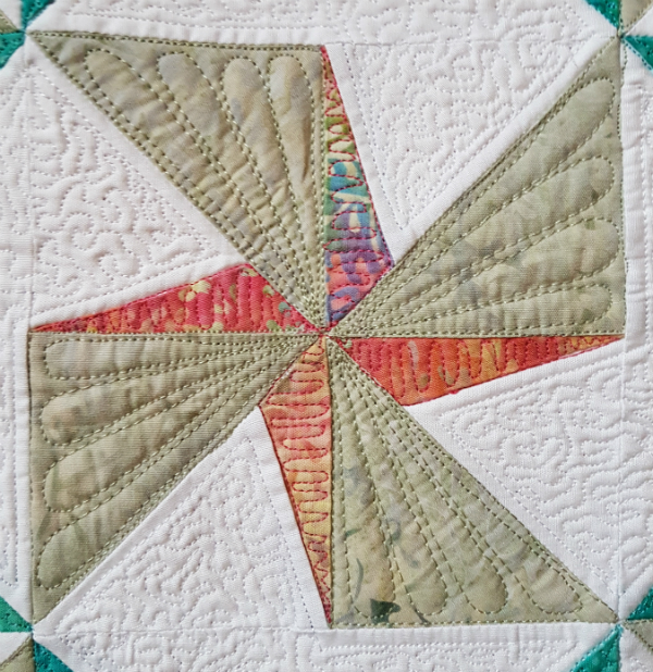 Twirling Star mini quilt | DevotedQuilter.blogspot.com