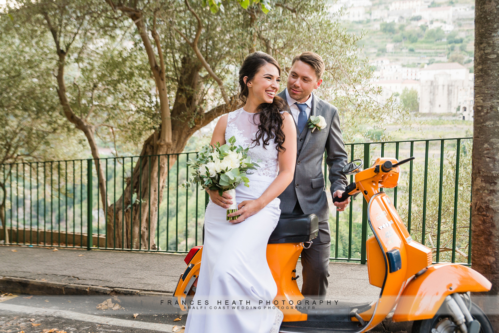 Bride and groom with vespa