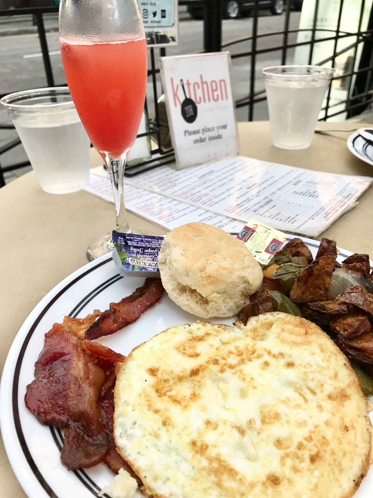 Bacon, eggs, biscuit and mimosa at Kitchen 208 in Charleston