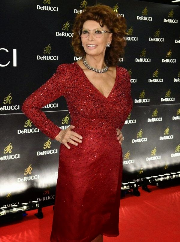 Sophia Loren Brings A Little Joy To The Red Carpet At Cologne Germany In A Scarlet Dress