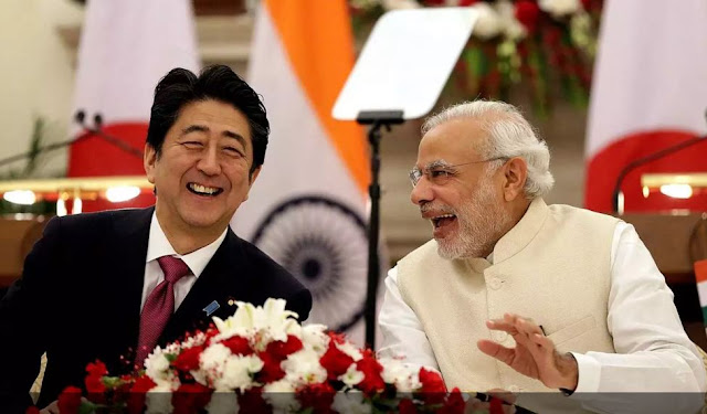 Image Attribute: Japanese Prime Minister Shinzo Abe and Indian Prime Minister Narendra Modi laughed after signing an agreement at Hyderabad House in New Delhi on Saturday, Decemebr 12, 2015. / Source: European Pressphoto Agency