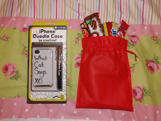 Doodle phone case and chocolates