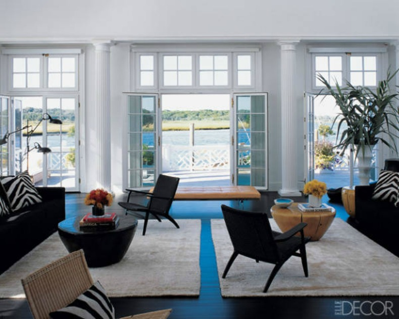 Coastal modern living room with bright whites and dark browns and an ocean view