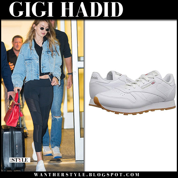 Gigi Hadid in cropped denim jacket, black leggings and white sneakers reebok model airport style september 1