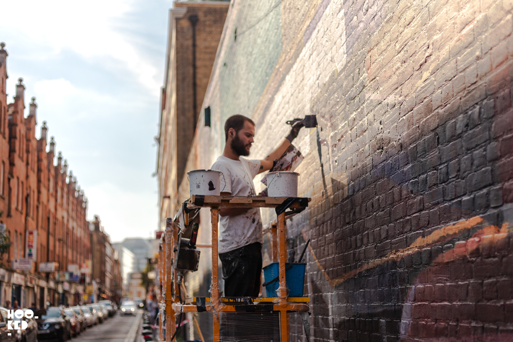 Artist Wasp Elder at work on a London Wall. Brick Lane street art