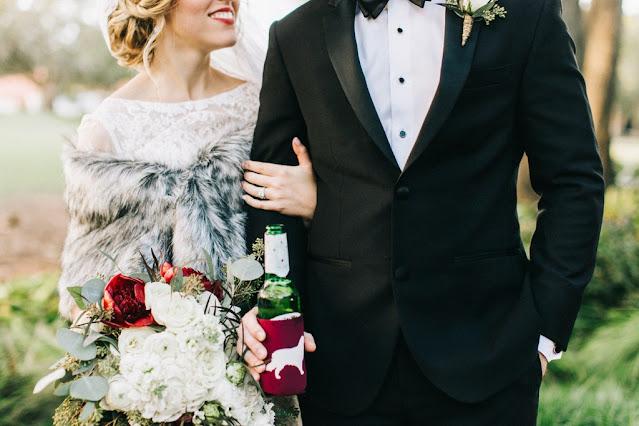 bride and groom holding beverage