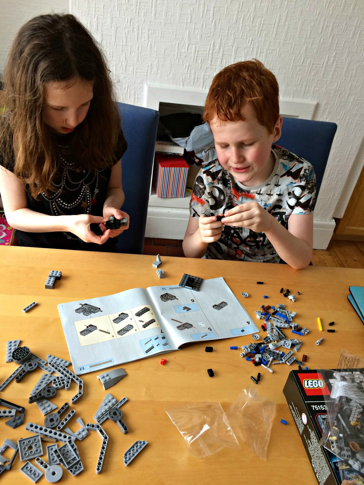 Caitlin & Ieuan assembling the Lego 75153 Star Wars AT-ST Walker Building Set